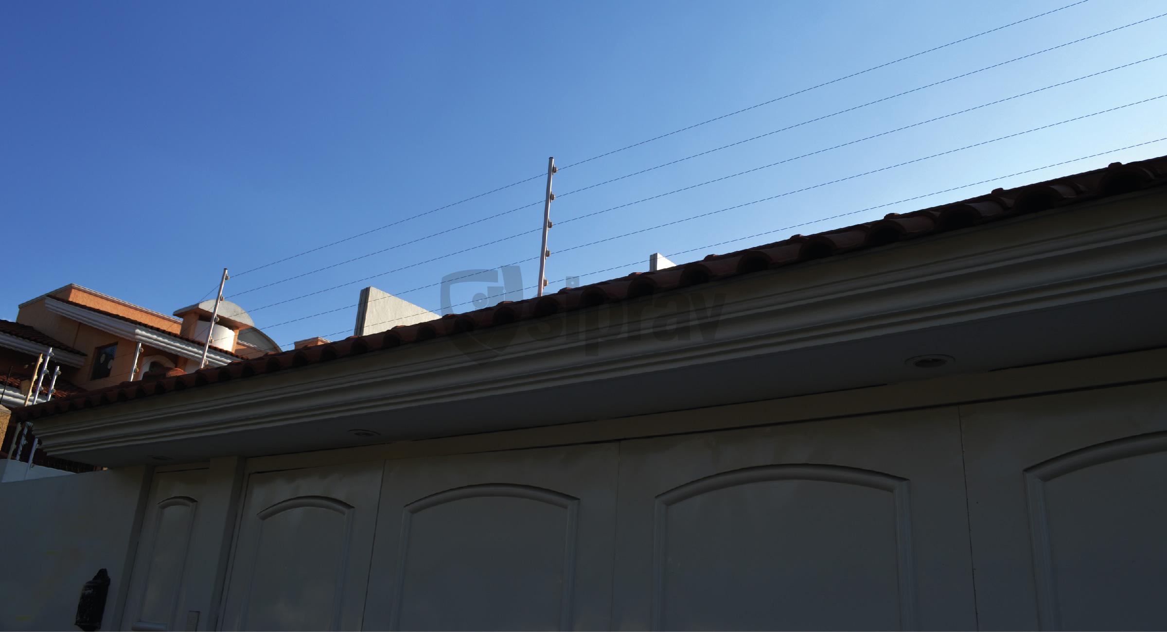Cercas Eléctricas Cercas Eléctricas en casa sobre teja